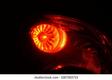 Close-up on red brake light on. Car stop. Car brake indicator.