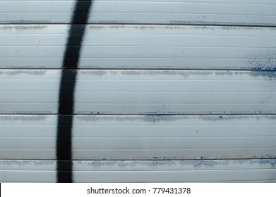 Closeup on roller shutter garage door abstract textured background