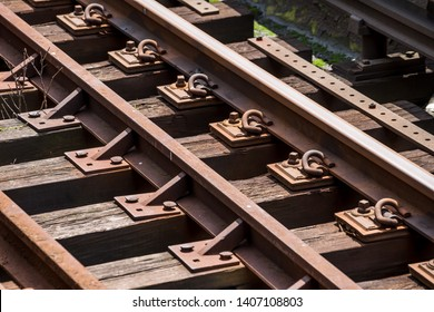 Close-up on Rusty Rails and wooden Sleepers