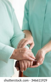 Close-up on senior woman's hands on a walking stick