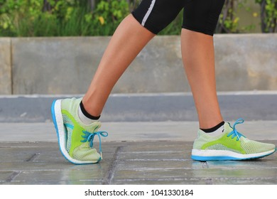 Closeup on shoe, Woman running on morning in the park, fitness and healthy lifestyle concept
