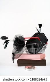 Close-up on shopping basket with female hat with veil in retro style and bag with makeup on gift boxes white background. Black Friday Thanksgiving Christmas shopping sale concept. Vintage, copy space