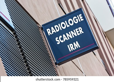 """Closeup on Sign on a building indicating radiology, MRI and medical scan services (""""Radiologie Scanner IRM"""" in French)"""