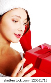 Closeup on teen pretty caucasian girl holding a gift over white.