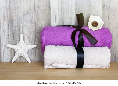 Closeup on Towels with a starfish. Concept Beauty Health Spa and Wellness.