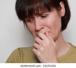 closeup on very sad depressive woman