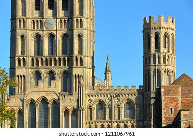 Close-up on the Western part of the Cathedral of Ely in Cambridgeshire, Norfolk, UK, with the clock tower on the left and a turret on the right