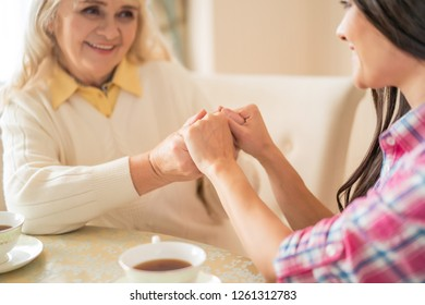 Close-up On Women Holding Hands. Close Up Shot Of Mother And Daughter's Hands Holding Together