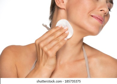 Closeup on young woman using cotton pads