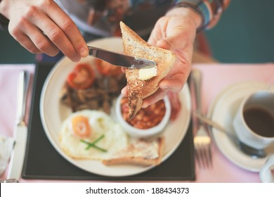 Photo of Closeup on a young woman's hands as she is having breakfast