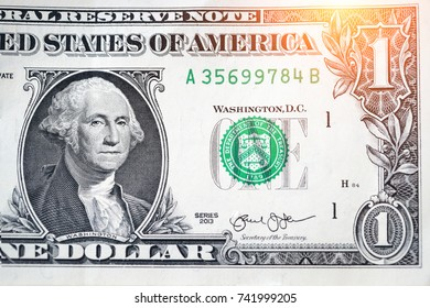 closeup one dollar banknote with sunlight effect