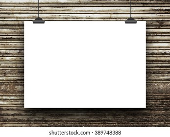 Close-up of one hanged blank frame with clips on rusty metal shutter background
