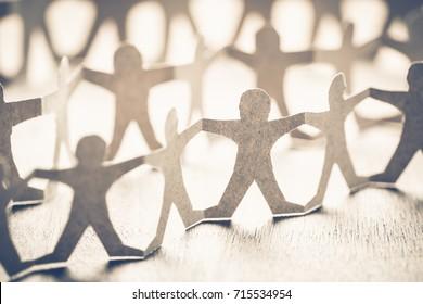 Closeup one of human chain paper, unique person in crowd concept