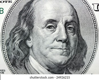 closeup of a one hundred dollar bill - Franklins face
