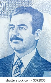 Close-up of one hundred Iraqi dinars banknote.  Features Saddam Hussein.