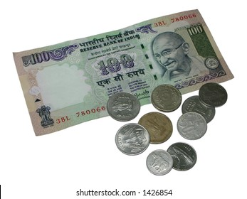 Closeup of one hundred rupee note and coins of different denominations
