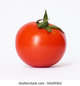 closeup of one red tomato on white background