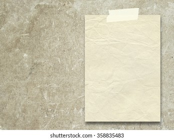Close-up of one vintage old paper sheet with tape on rough brown plaster wall background