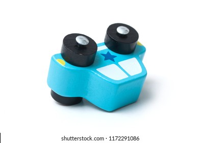 Closeup of one wooden toy car on the roof on white background, Transport and accident concept