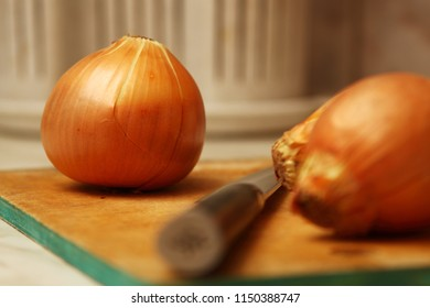 Close-up of onions on the kitchen table.