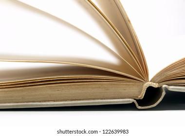 Closeup of an open book concept paper