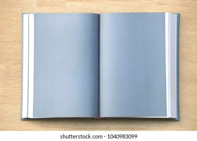 Close-up of open book lying on the floor selective focus and shallow depth of field