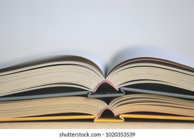 Close-up of open book on the floor selective focus and shallow depth of field
