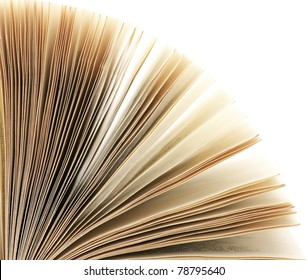 Close-up of open book on white background.