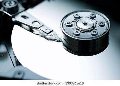Closeup of an open computer hard drive.