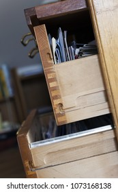 Close-up of open drawers full of papers