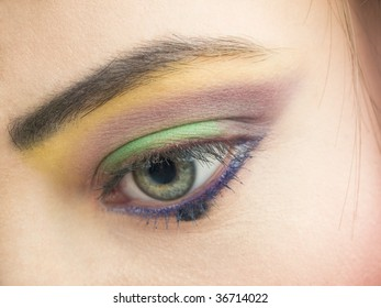 closeup of open eye with beautiful colorful makeup