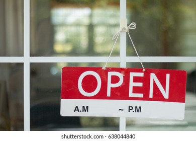Closeup of open sign on glass door at coffee shop, Time to open shop.