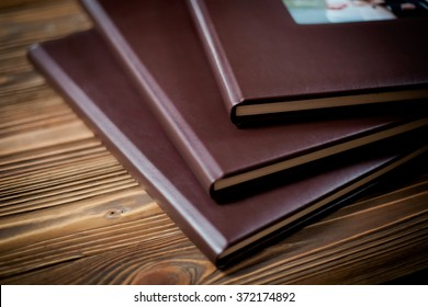 Closeup of opened book pages. Wedding photo album detail  Education concept.
