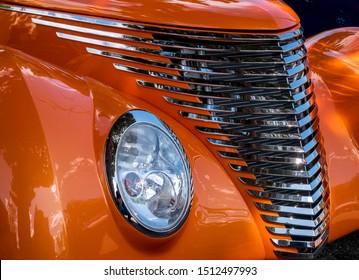Closeup of an orange classic custom car at a show in Lakewood, Colorado