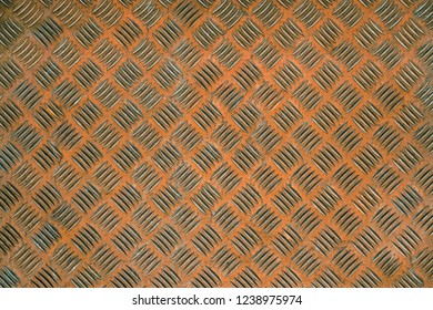 Close-up of a Orange colored metallic Background Texture or Steel Surface.