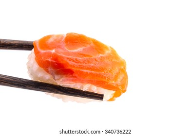 Close-up of Orange fresh salmon sushi nigiri in chopsticks isolated on white  background