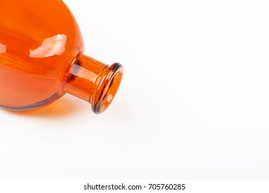 Close-up of orange glass jar on white background. Isolated. Container.