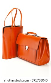 Closeup of orange leather bags on white background