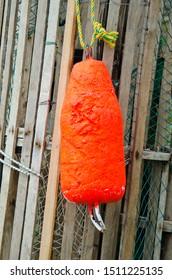 Closeup of orange lobster buoy in Lunenburg, Nova Scotia