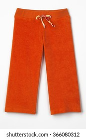 Closeup of orange sweatpants on white background