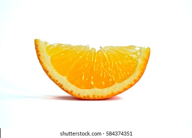 Closeup of an orange wedge on a white background