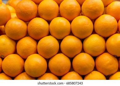 Closeup of oranges on a market
