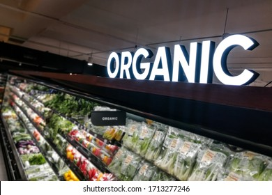 Closeup of organic produce vegetable fruits aisle with signage word in supermarket