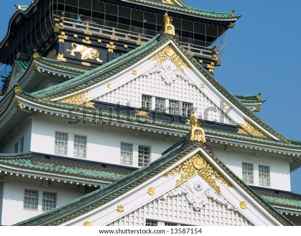Close-up of Osaka Castle showing gold decorations and windows