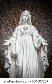 Close-up of Our Lady with open arms, bottom view.