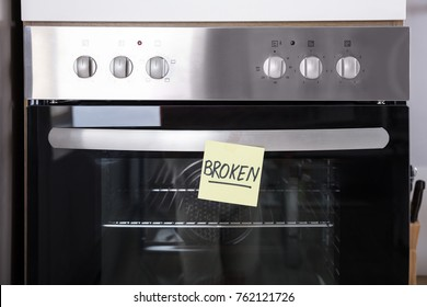Close-up Of A Oven With Sticky Notes Showing Broken Text