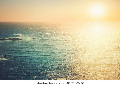 Closeup of pacific ocean at sunset with sun track