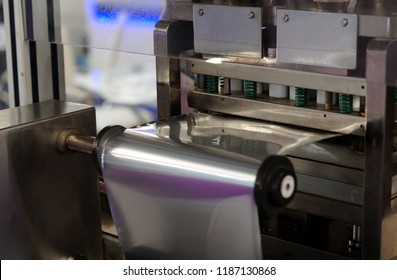 Closeup of packaging equipment in pharma or chemical manufacturing plant or industry