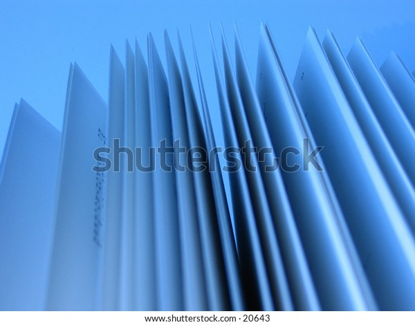 Close-up of pages of an open book in blue tone.