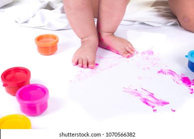 closeup painted in bright colors feet. isolated on white background.